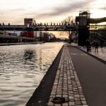 People walking through La Villette Park in Paris close to the water channel